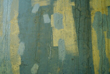 Abstract Design Of Green And Yellow Paint Covering Graffiti On A Concrete Water Tank