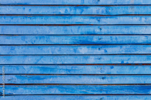 Photo Weathered old dark blue wooden fence, horizontal planks, close-up