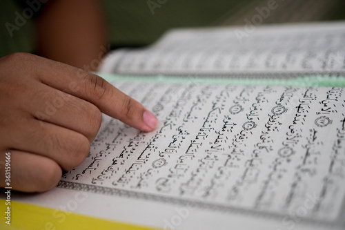 Cropped Hand Of Person Reading Holy Book Fototapet