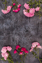 Vertical Dark Abstract Background With A Place For Text, Spray Roses Of Two Shades Of Pink Are Embedded On The Top And Bottom Sides.