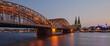Illuminated Bridge Over River Against Sky In City
