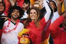 Excited Sports Fans Cheering Their Team