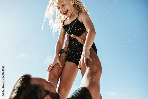 Fotografiet Father playing with her daughter outdoors