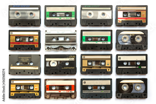 Fototapeta Collection of old audio cassette tapes isolated on white background, vintage mus