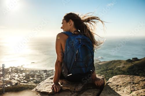 Fototapeta Hiker relaxing on mountain top obraz