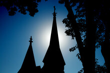 Church Steeple With Sun Behind...