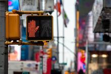 Stop, Dont Walk Red Hand Traffic Signal For Pedestrians In Manhattan, Defocused Street Background, New York City, USA
