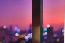 Close-up Of Pole Against Illuminated Lights At Dusk