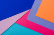 abstract geometric background with orange, pink, blue and violet paper