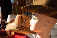 Close-up Of Vintage Mannequin Head And Cowboy Hat At Flea Market