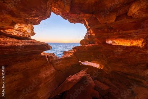 Fotografiet Sea Seen Through Rock Formations