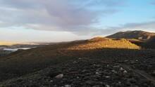 Pan Right Reveal Golden Light On High Desert Mountains Nevada.