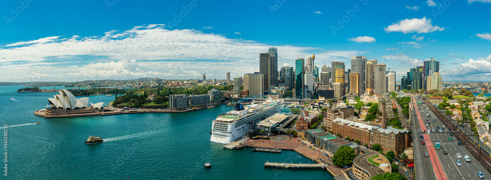 Fototapeta Panorama view of Sydney harbor bay and Sydney downtown skyline with opera house in a beautiful afternoon, Sydney, Australia.