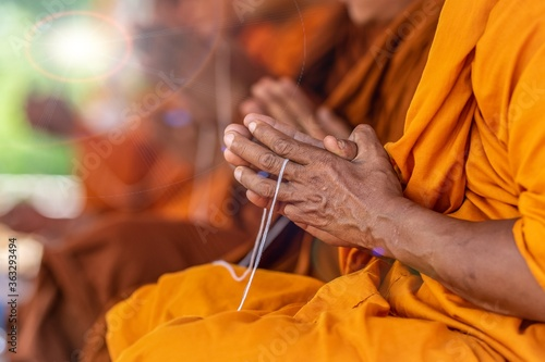 Valokuva Midsection Of Monks Playing While Sitting In Temple