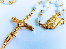 High Angle View Of Rosary Beads On White Background