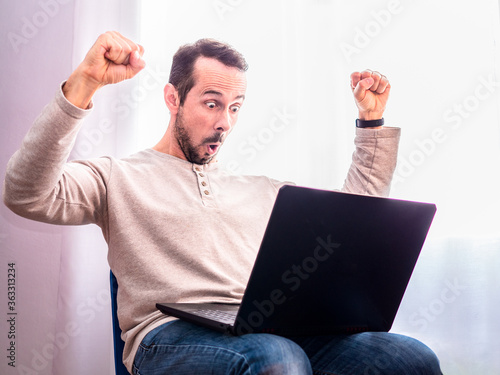 Fotomural Man with his arms up for having had some achievement at work or for having won t
