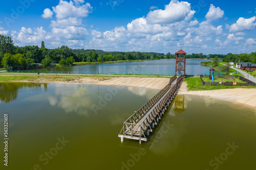 Fototapeta Aerial view of a smal wooden dock on a lake obraz