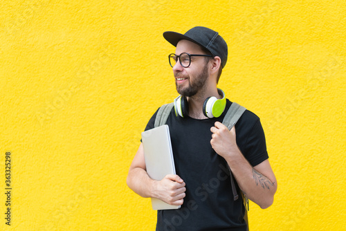 Fotografie, Tablou Half-length portrait of casually dressed smiling bearded man with a backpack and