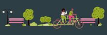 A Couple Rides A Tandem Bike T...