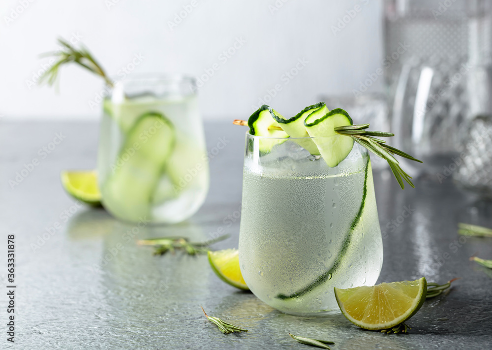 Fototapeta Detox drink or green iced refreshing lemonade with rosemary, cucumber and lime.