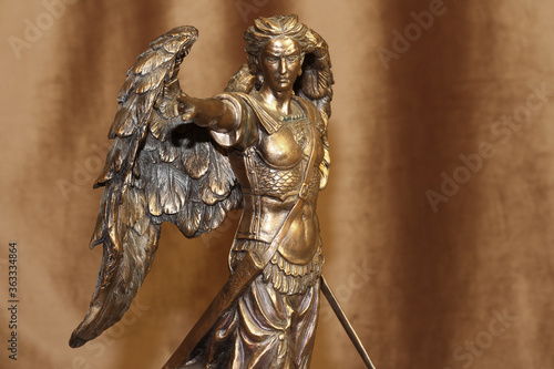 Statuette of the Archangel Michael on a velour background. Canvas Print