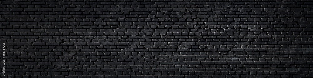 Fototapeta Texture of a black painted brick wall as a background or wallpaper