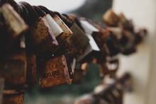 Close-up Of Rusty Padlocks On Railing