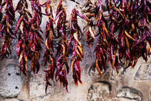 Close-up Of Red Chili Peppers Hanging In Market