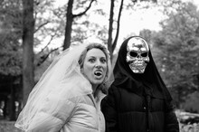 Bride With Fang Teeth And Her Skeleton Groom Dressed For Halloween