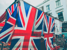 Low Angle View Of Union Jack Flag Against Buildings In City