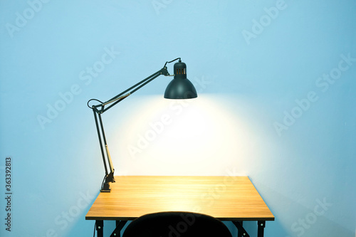 Illuminated Lamp On Table Against Wall Canvas Print