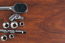 High Angle View Of Socket Wrench On Table