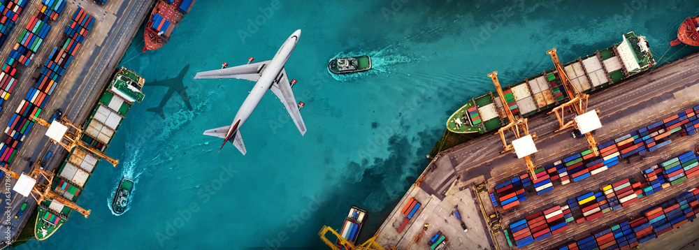 Fototapeta Aerial view and top view cargo plane flying above ship port in the export and import business and logistics international goods. Shipping cargo to harbor by crane