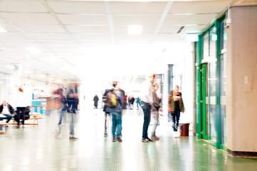 People Walking In Illuminated School