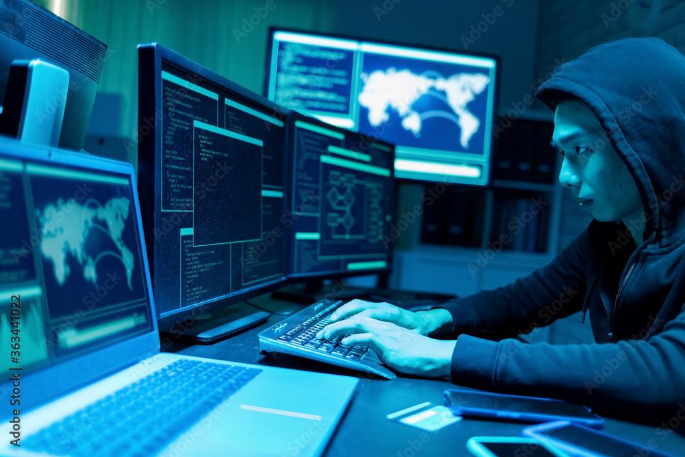 Fototapeta Asian male hacker use computer