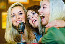 Women Singing With Microphone