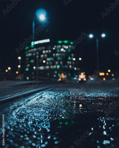 Fototapeta Close-up Of Wet Street Against Sky At Night