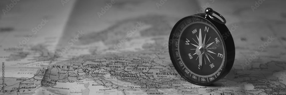Fototapeta ompass on the tourist map. Focus on the compass needle