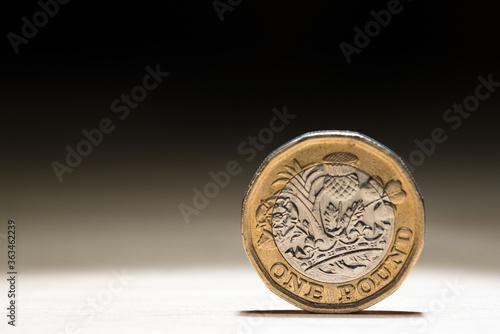Fototapeta Close-up Of British Pound Coin On Black Background obraz