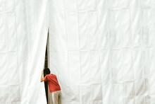 Rear View Of Boy Peeking Through White Tent
