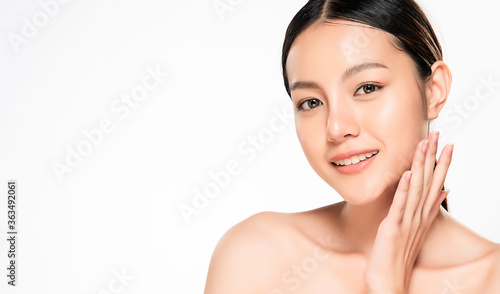 Photo close up Beautiful Young asian Woman touching her clean face with fresh Healthy