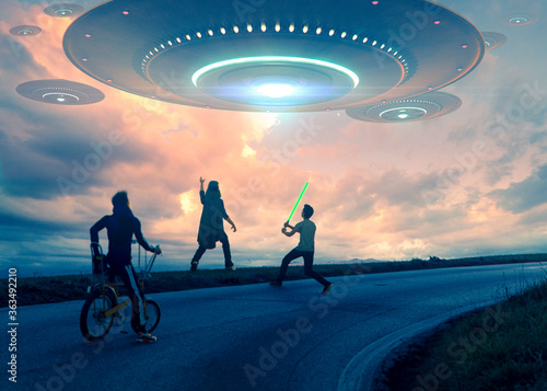 Alien invasion of a big flying saucer  in a beautiful sunset sky while children Wallpaper Mural