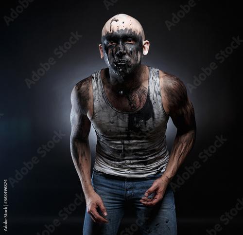 Obraz na plátně Image of bald mad man with black vomit in the mouth