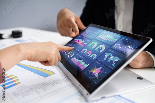 Financial Analyst Using Convertible Laptop Screen