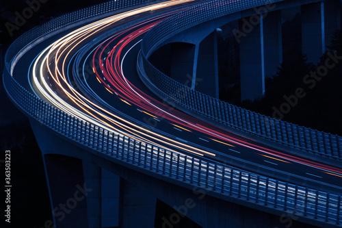 Obraz na plátně Light Trails On Bridge At Night