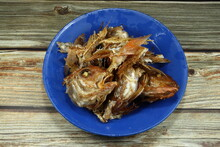 Food Scarp, Fish Bones (fish Leftovers) On The Plastic Plate. Bones And Fish Heads Texture For Making Fertilizers.