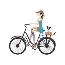 A Woman Biking, A Small Dog O...
