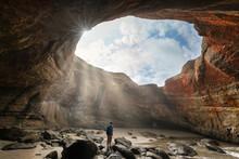 Hiker In The Ocean Cave Of Dev...