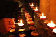 Lighting A Prayer Candle In A ...
