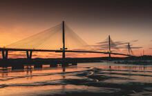 Silhouette Suspension Bridge Against Sky During Sunset